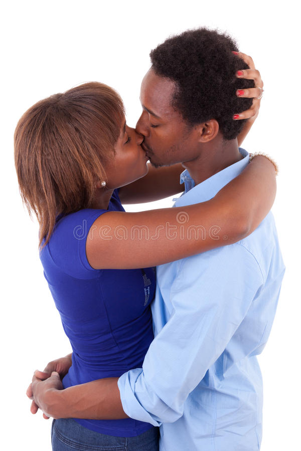 African American young couple kissing - Black people. Isolated on white background royalty free stock photography