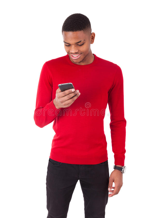 African American young man sending a text message on her smartphone - Black teenager people stock photo