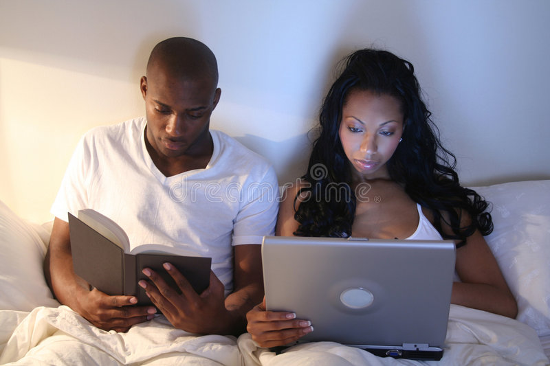 African Amrican Couple in Bed. African American Couple - Married People - Lovers royalty free stock image