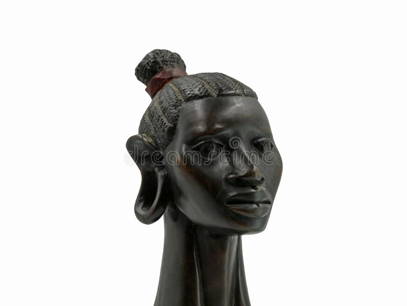 African antique black ebony head of a woman isolated on white background stock photo