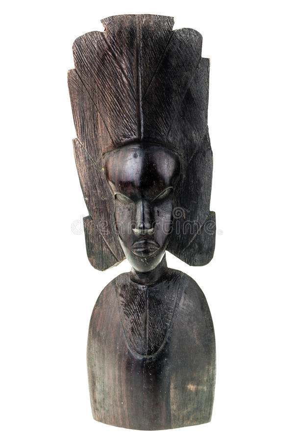 African artifact. An ancient african black wood carved artifact isolated over a white background stock photography