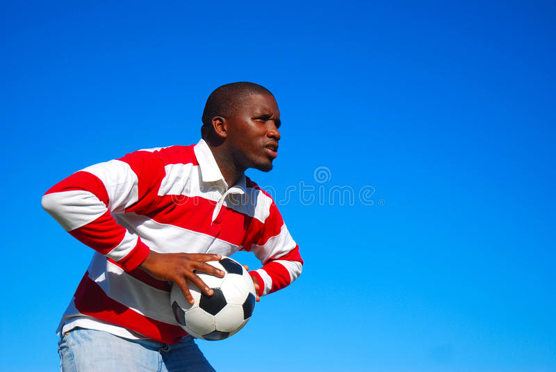 African black man with soccer ball stock photo