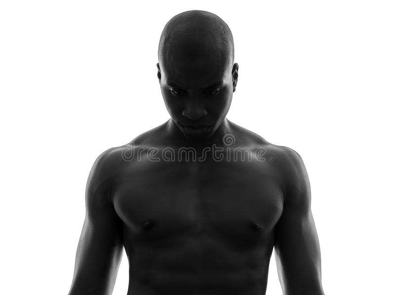 African black man topless looking down sad silhouette. One african black man topless looking down sad in silhouette studio on white background stock images