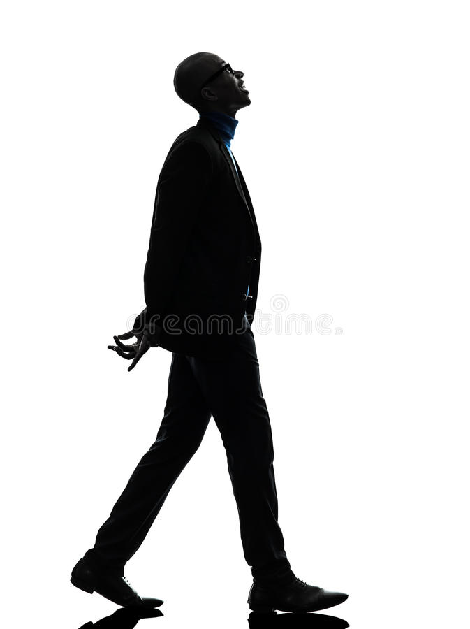 Download African Black Man Walking Looking Up Smiling Silhouette Stock Photo - Image: 31365594