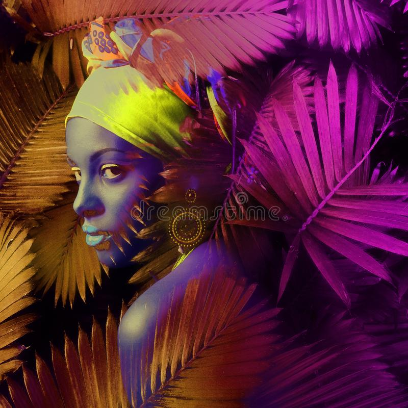 African black young woman  portrait with turban neon colors composite photo stock images