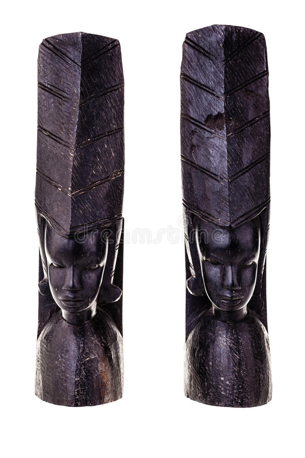 African bookends. An ancient african black wood carved artifact isolated over a white background stock images