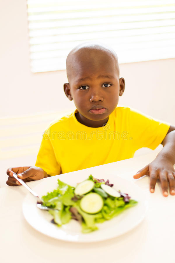 African boy healthy meal. Portrait of cute african boy enjoying healthy meal stock photography