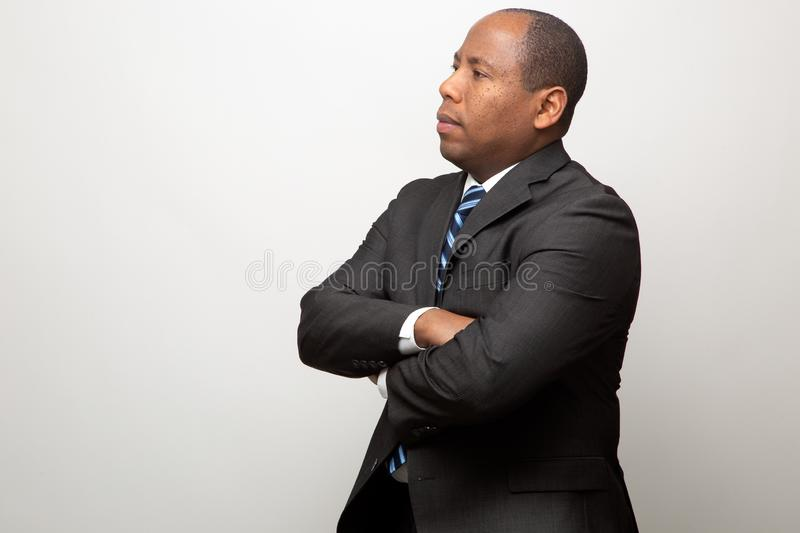 African Business Man Dressed in Suit Thinking On Light Gray Background royalty free stock photo