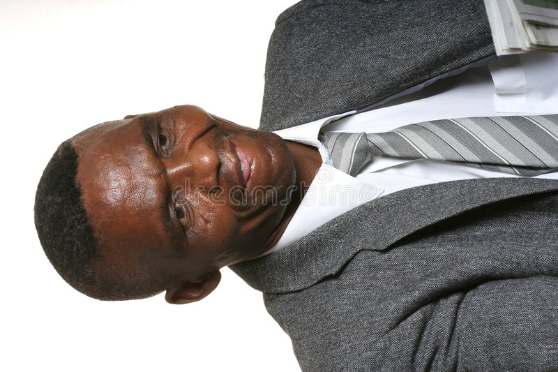 African Business Man reading stock image