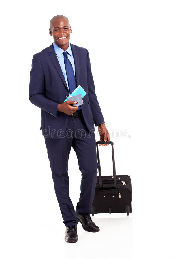 African business traveler. With trolley bag and air ticket royalty free stock images