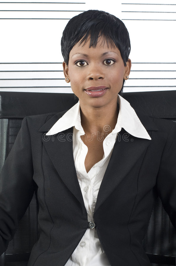 African Business Woman. Young attractive african business woman in a modern office setting royalty free stock image