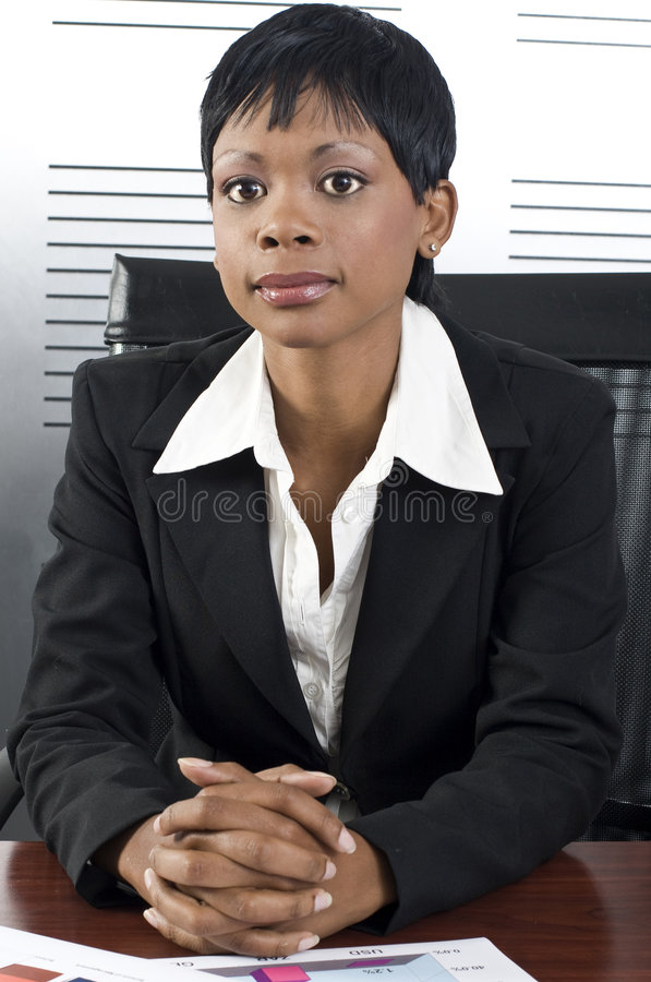 African Business Woman. Young attractive african business woman in a modern office setting stock image