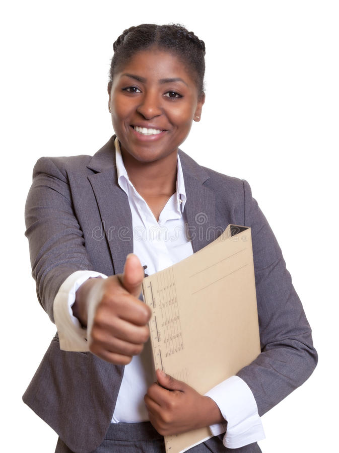 African business woman with file showing thumb up. On an isolated white background for cut out stock photo