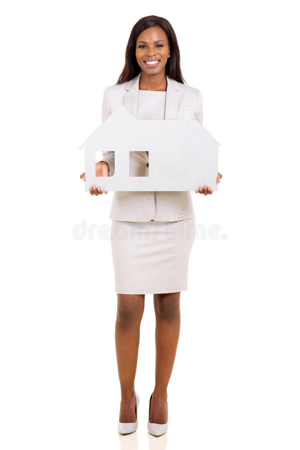 African business woman. Happy african business woman holding house symbol on white background royalty free stock photo