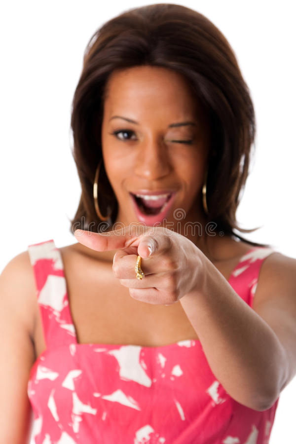 African business woman pointing index finger. Beautiful African American business woman in pink with white spring summer halter dress pointing her index finger stock photography