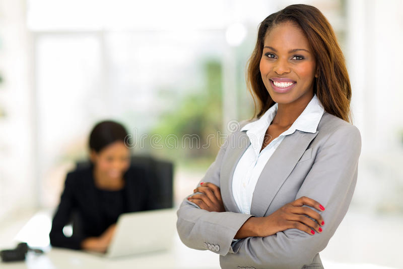 African business woman. Smart african business woman in office stock photo