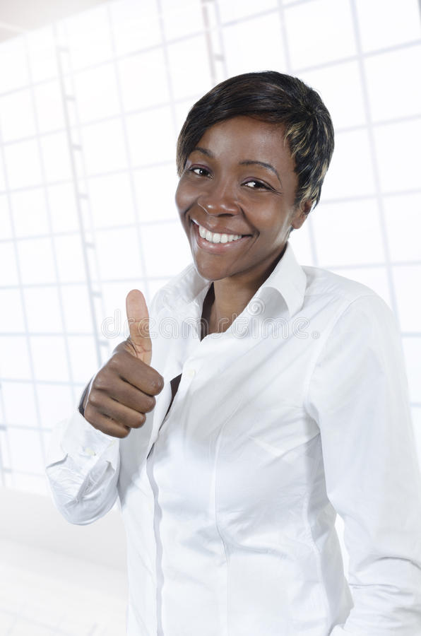 African business woman thumb up. Studio Shot stock images
