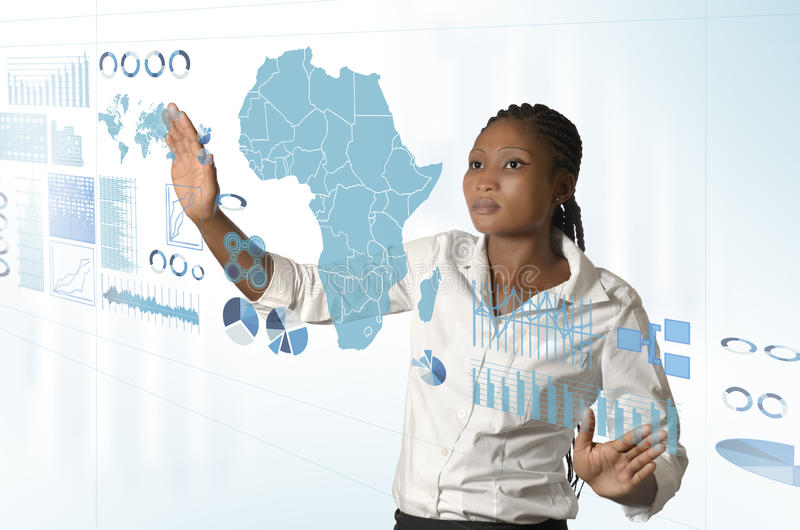 African business woman working on virtual touchscreen. Studio Shot stock images