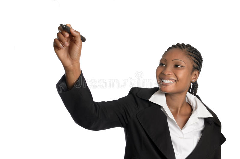 African business woman writing in free copy spave. Studio Shot stock photography