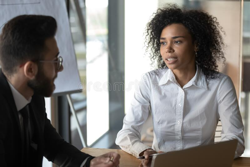 African businesslady talking to arabian client make profitable proposition stock photo