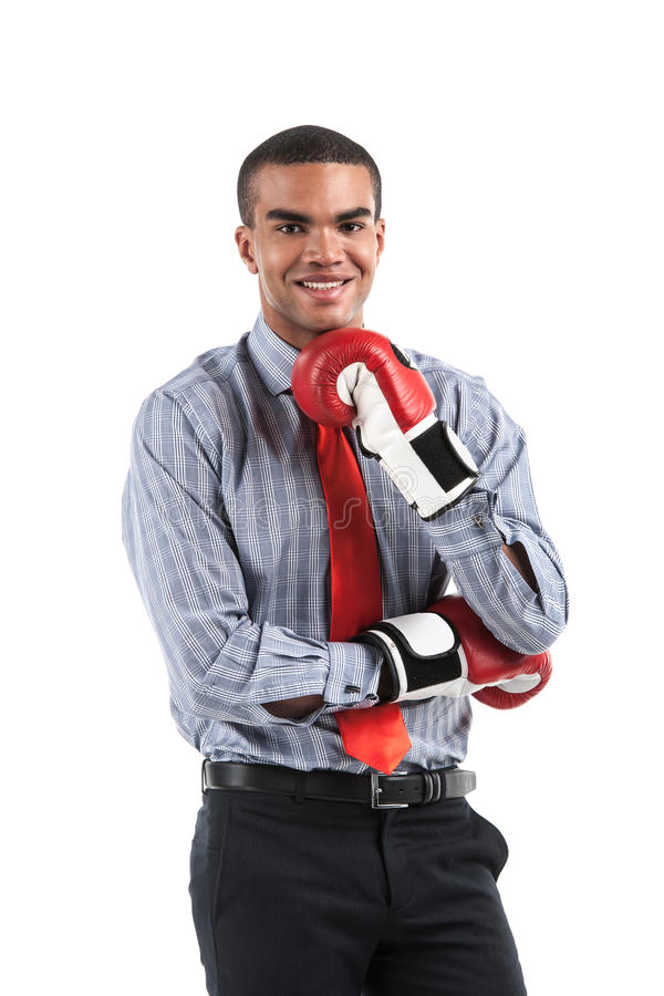African businessman in boxing gloves over white background. royalty free stock images