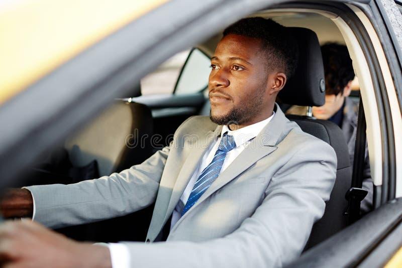 African Businessman Driving Car stock photos