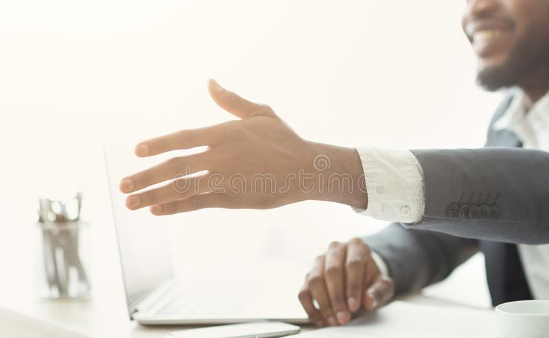 African businessman gives hand for handshake proposes partnership stock photography