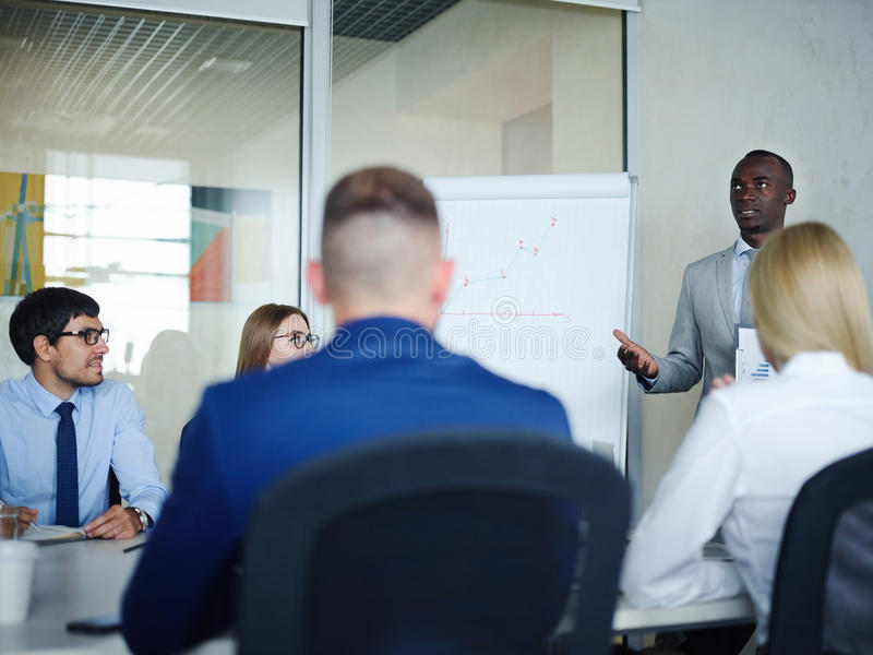 African Businessman Leading Presentation in Company royalty free stock photography
