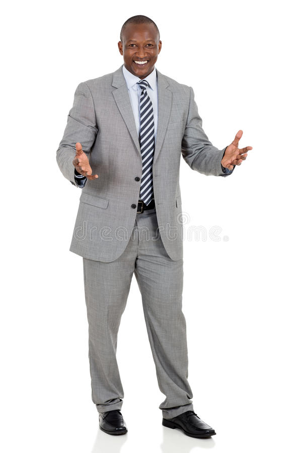 African businessman looking. Cheerful african businessman looking at the camera royalty free stock photo