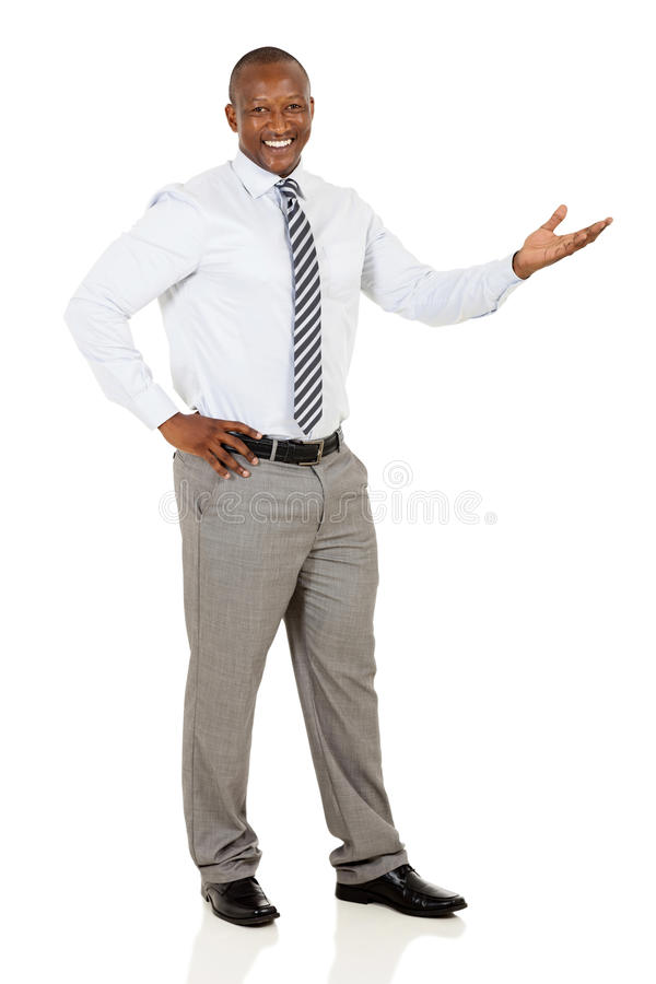 African businessman welcome gesture. Happy african businessman doing welcome gesture on white background royalty free stock photo