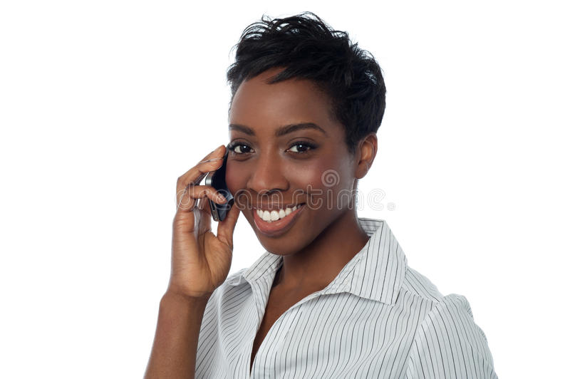 African businesswoman communicating. Business lady speaking over cellphone royalty free stock images