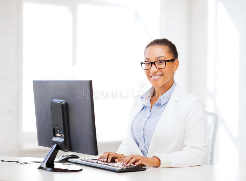 African businesswoman with computer in office stock photo