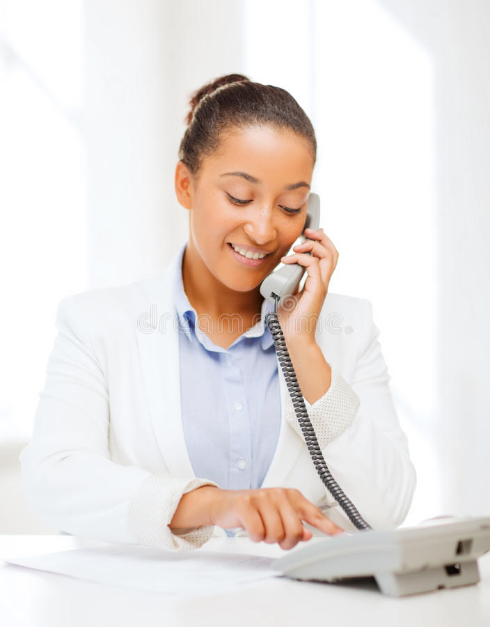 Download African Businesswoman With Phone In Office Stock Image - Image: 34392347