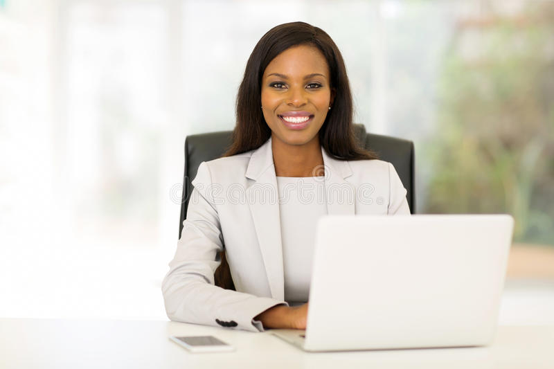 African businesswoman sitting stock images