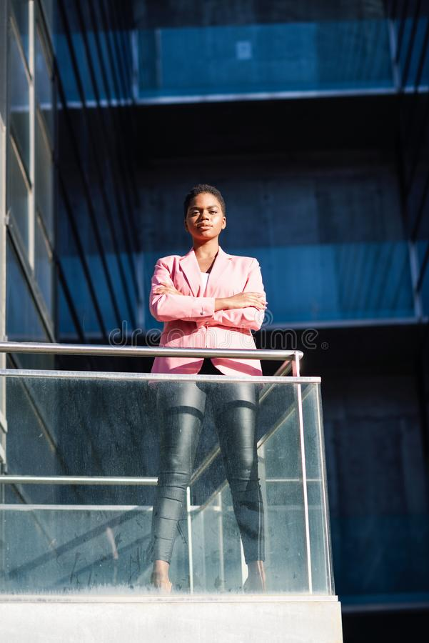 African businesswoman standing near business office building. stock photos