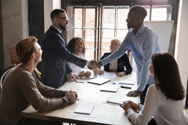African caucasian ethnicity businessmen party leaders shaking hands starting negotiations royalty free stock photography