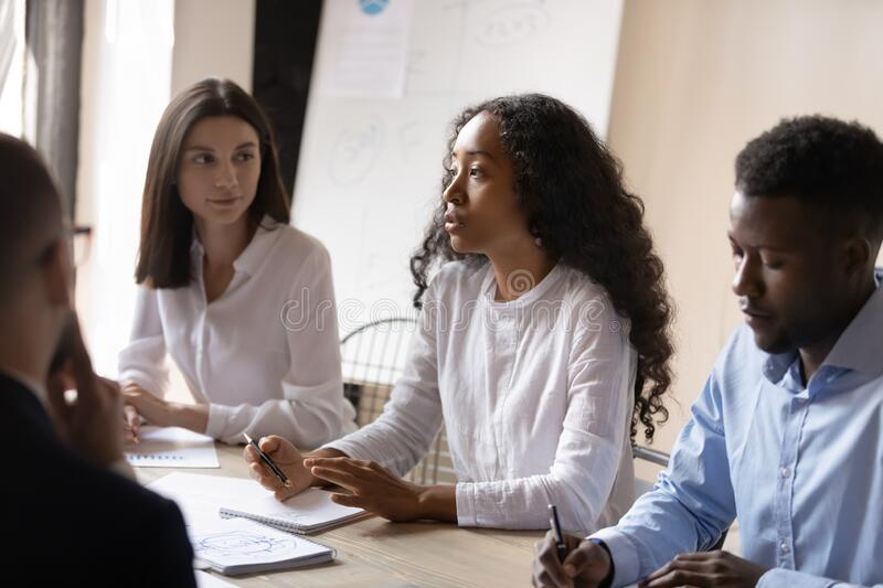 African ceo express opinion share solution ideas in group meeting royalty free stock photo