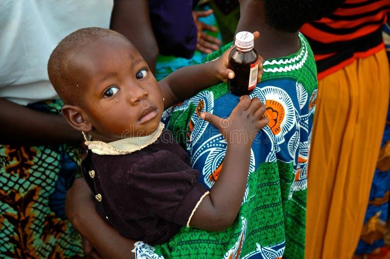 African Child Holding Medicine stock photo