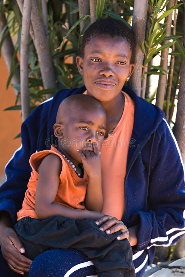 African child and mother stock images