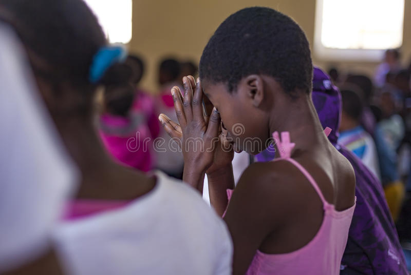 African Child Praying stock photography