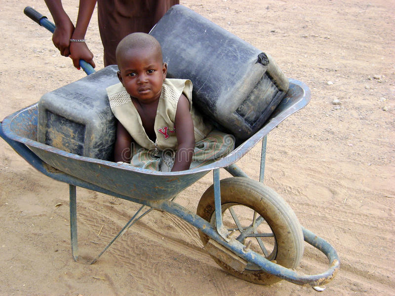 African child in a wheelbarrow stock images