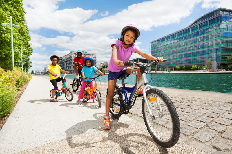 African children riding bikes one after another royalty free stock photos