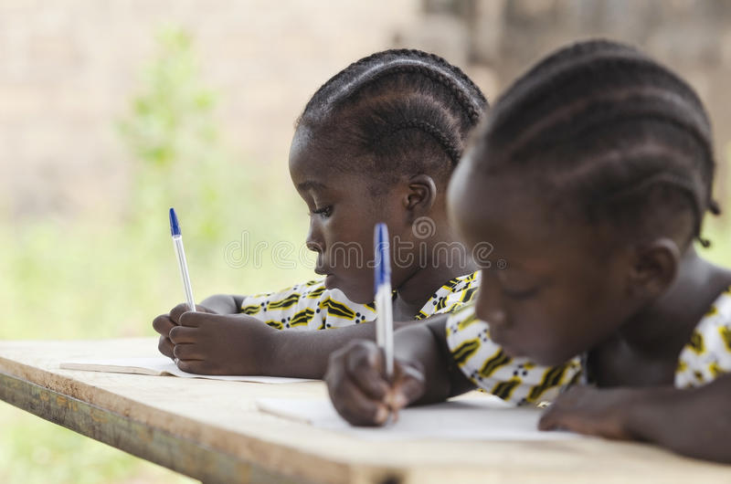 African Children at School Doing Homework. African ethnicity stu stock photography
