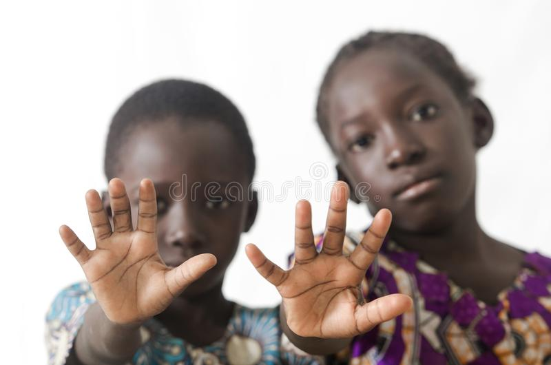 African children showing hand palms as a stop sign, isolated on stock photos