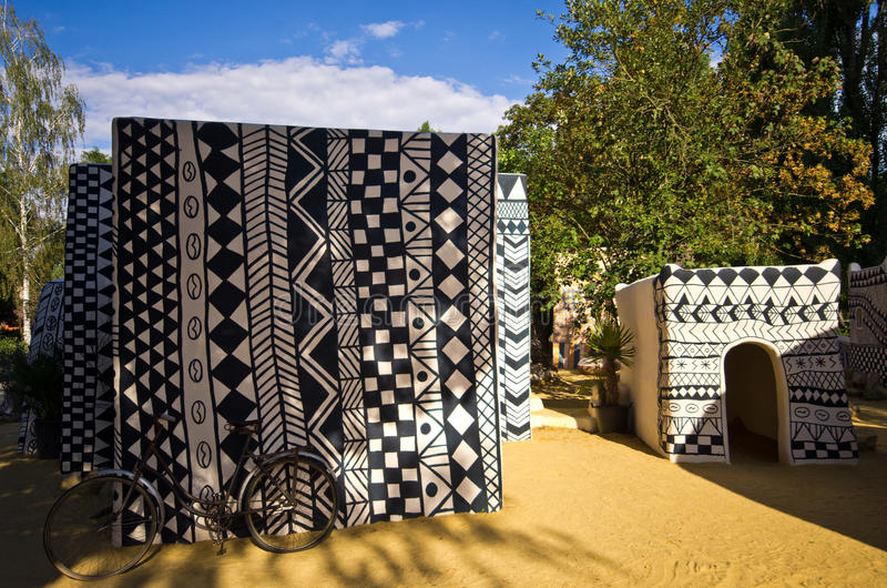African clay huts at Zoo Safari, Dvur Kralove. Czech Republic, Dvur Kralove. Zoo Safari and African corner with imaginative clay hut painted in folk patterns stock image
