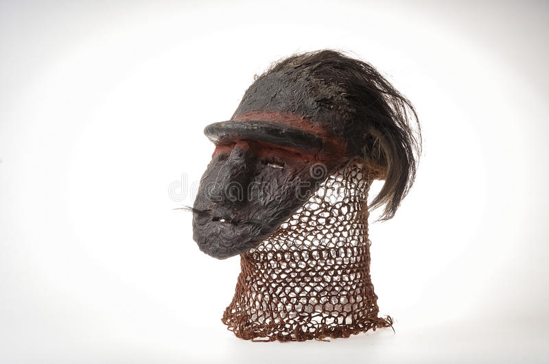African clay mask. With human hair. stock image