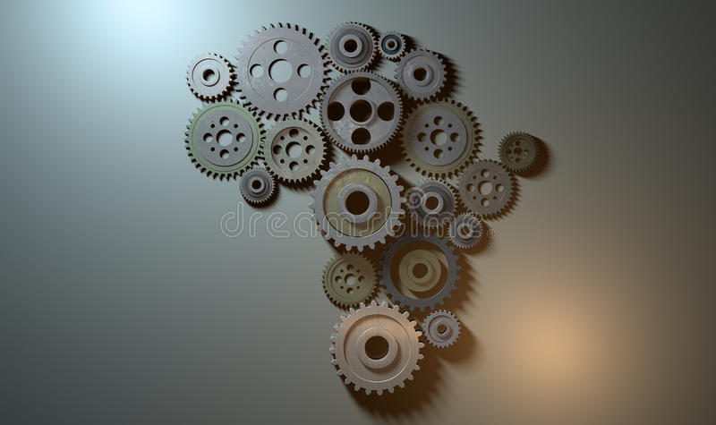 African Cogwheel Machine. A concept showing an array of metal and steel cogwheels assemed into the shape of the african continent on a light surface background stock images