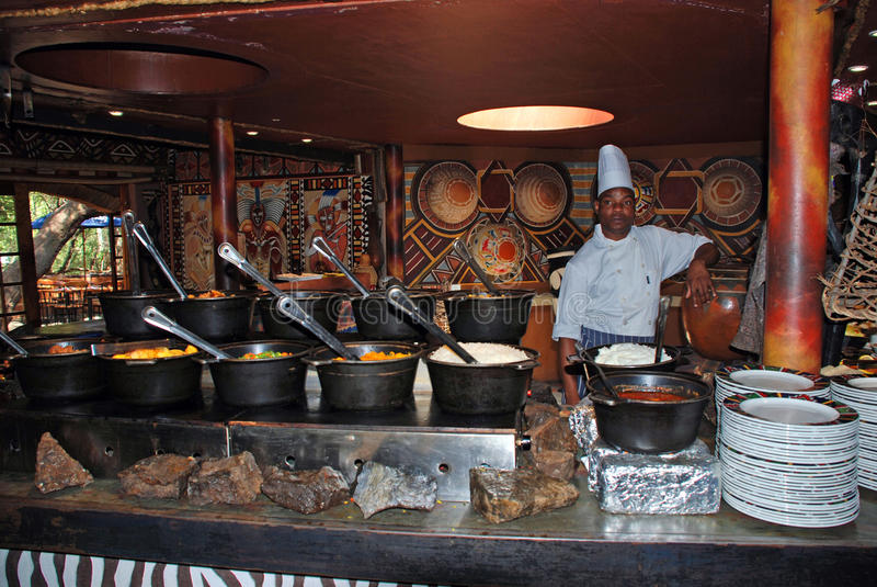 African cook in tribal restaurant south africa editorial for African cuisine restaurant