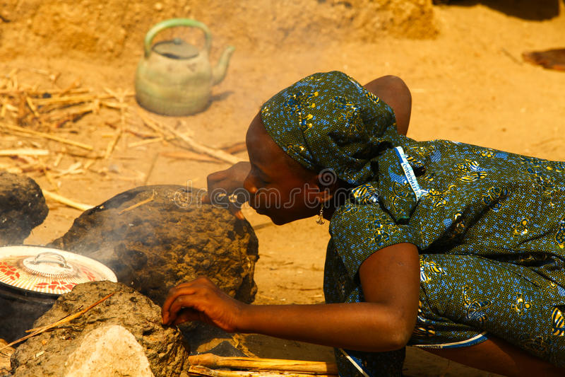 Download African Girl Cooking editorial stock image. Image of child - 34127954