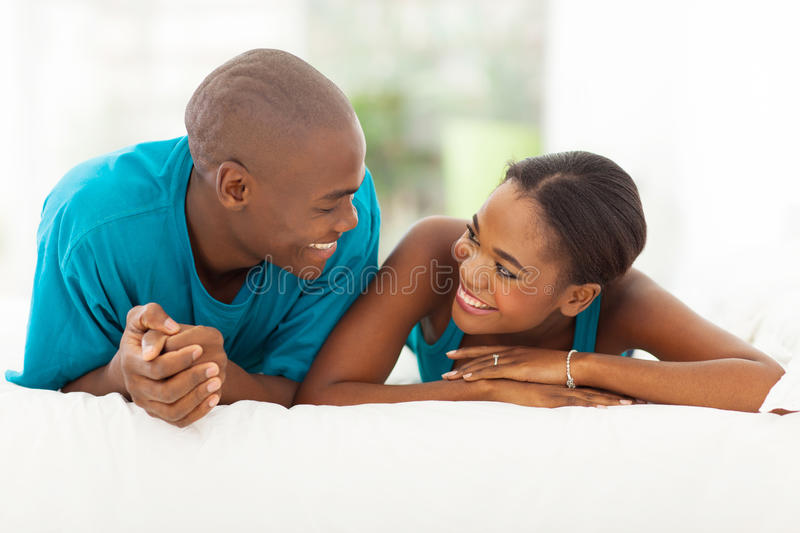 African couple bed stock photos
